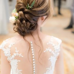 textured braided updo for wedding gown